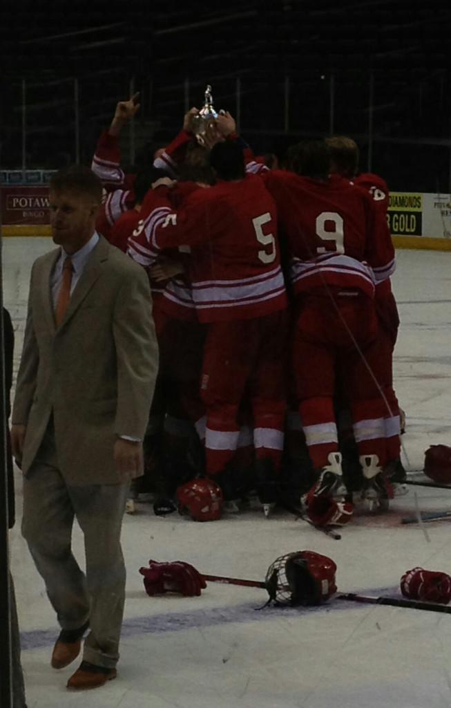 #5 Tristan Rostagno and his Arrowhead Warhawk teammates celebrating after they won the Admiral Cup Championship in their 2012-2013 season