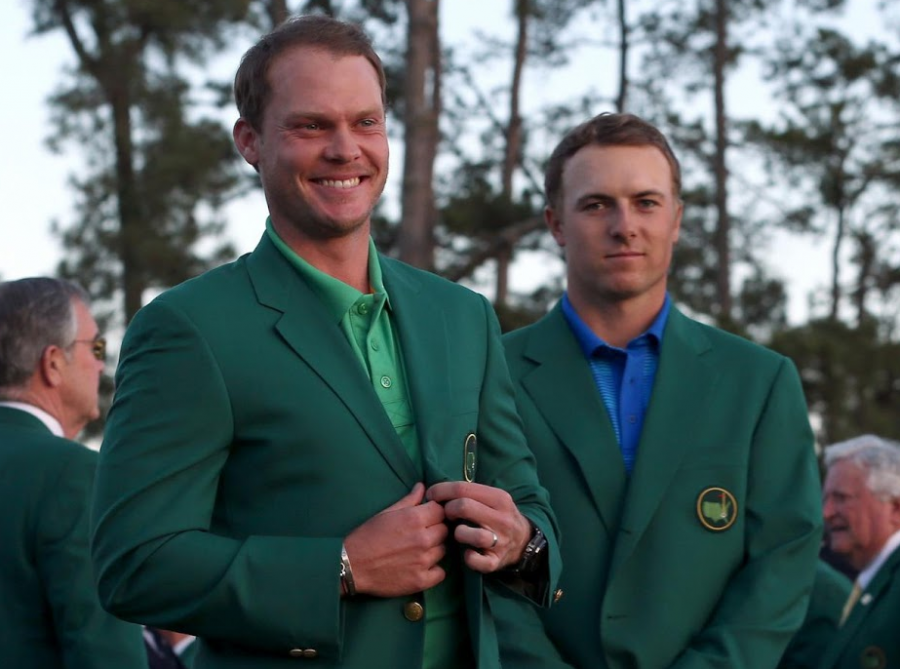 Danny Willett (Left) receives green jacket presented to him by Jordan Spieth (Right) at the 2016 Masters ceremony.
