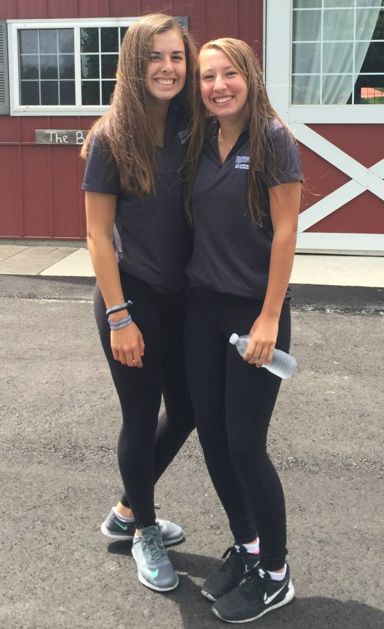 Sophomores Molly Leyden and Lily Gallagher at work at the Rustic Manor