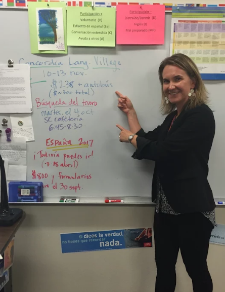 Amy Coraggio points at the information for Concordia Language Village on September 22, 2016 in her classroom at North Campus to encourage students to join the trip.