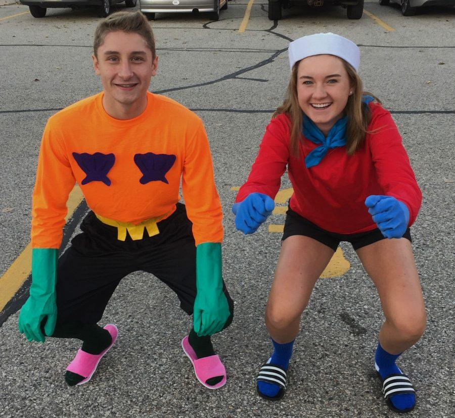Juniors Sarah Ernst and Chase Zastrow, dressed up as Mermaid Man and Barnacle Boy from Spongebob Squarepants for Famous Pair Tuesday, pose for a picture in the North campus parking lot in their Invisible Boatmobile