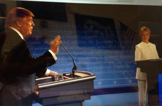 Still of the candidates on stage in Las Vegas on Wednesday, October 19th debating the 2nd Amendment.
