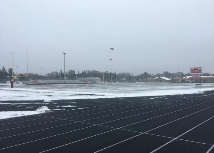 The Arrowhead Football Field covered with Snow.