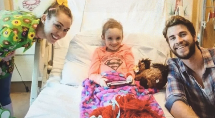 Miley Cyrus and Liam Hemsworth Smile with Cancer Patient Julia Davidson During a Visit at Rady Childrens Hospital