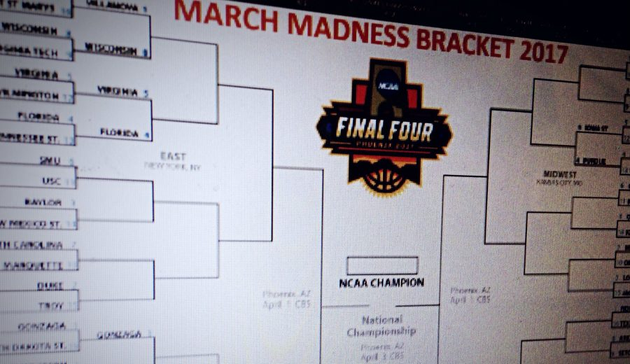 A partially filled out 2017 March Madness bracket with near endless combinations to decide from with hopes of making money off of.