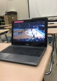 Students watching the March Madness games during class.