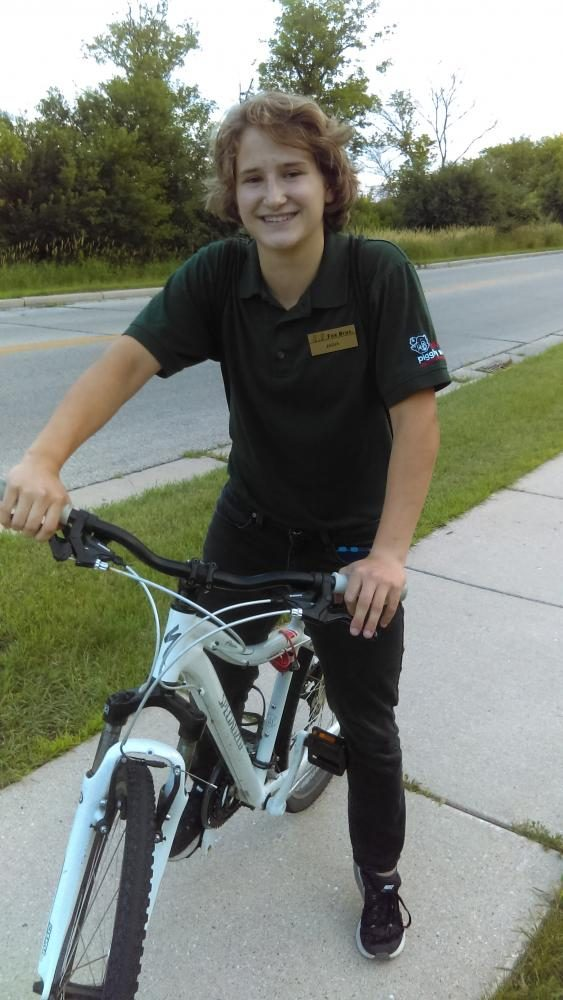 Rising junior Anna Shueth rides her bike home from work at Hartlands Piggly Wiggly