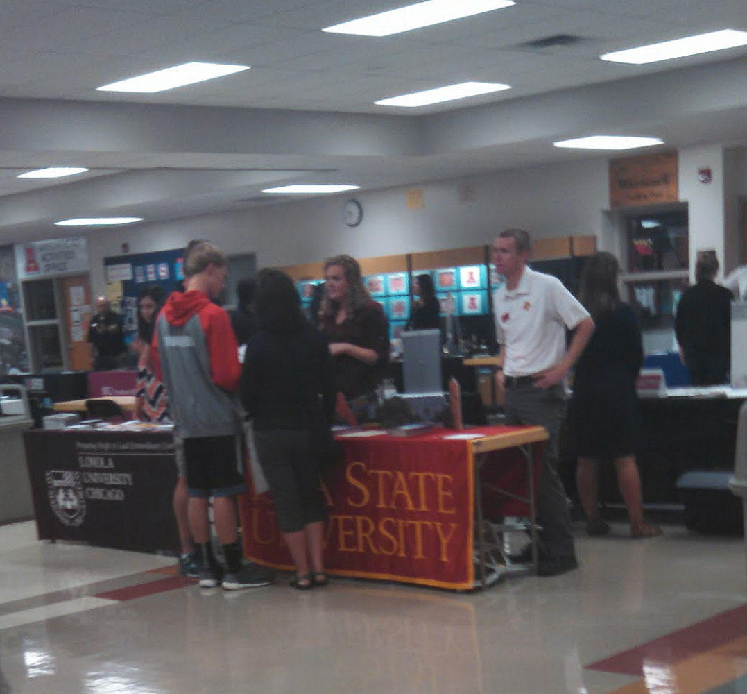 Arrowhead students speak with college representatives at the college fair.