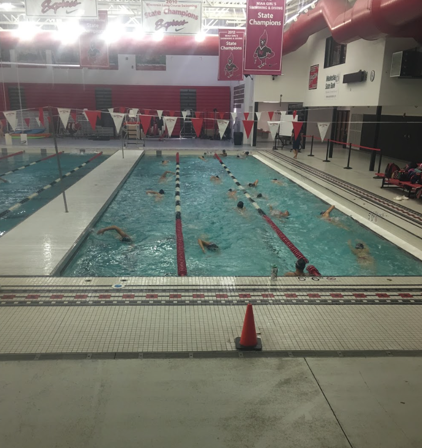 Lake Country Swim Team swimmers warming up for a meet at Waukesha South.