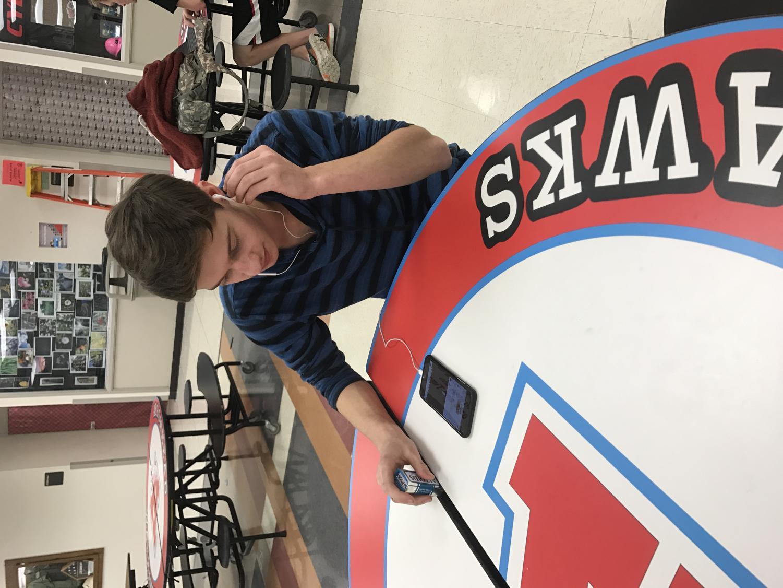 Chris Krier destressing with some music in senior studyhall