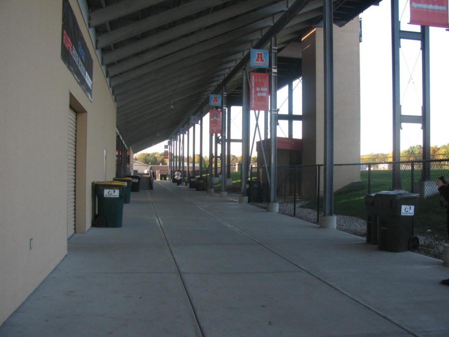Students commuting between North and South campuses travel under the football stadium and around the school to the front doors.
