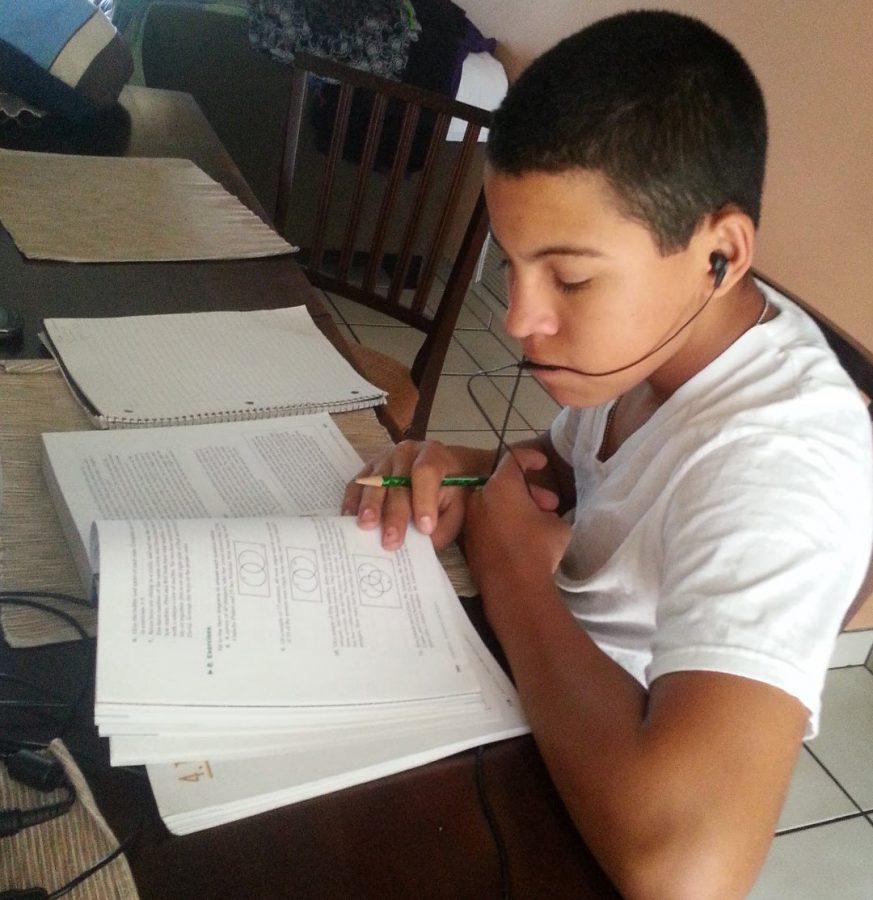 Noah Flegel listens to his favorite music at home whilst doing homework.