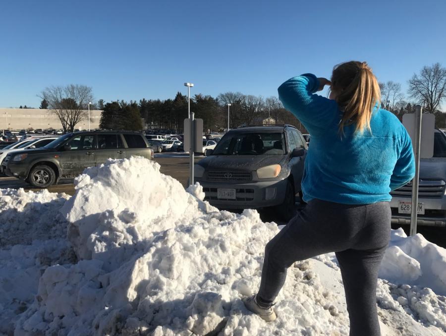 Marleh Lehmann playing in the AHS parking lot snow.