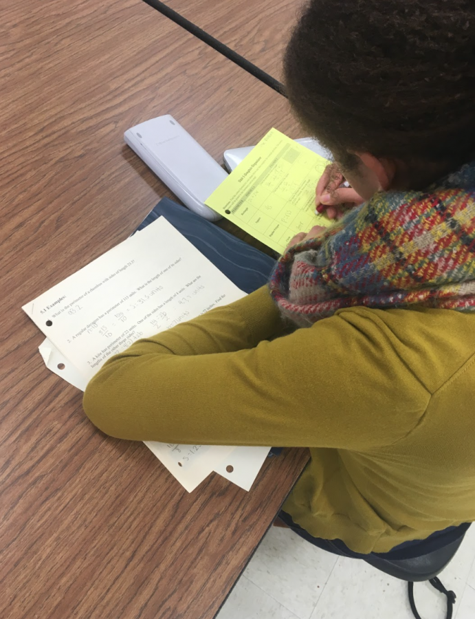 Sophomore Chloe Relford (mentioned in article) works on her geometry homework during her study hall on December 15th.