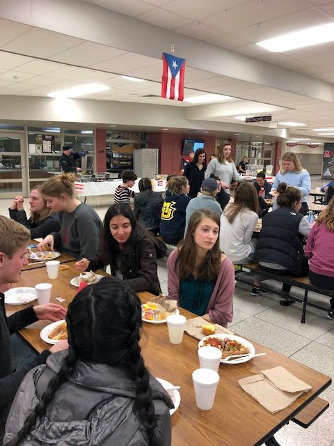 Students enjoy traditional Puerto Rican food at Tertulia event in North Campus commons on Thursday, January 25th after semester finals.