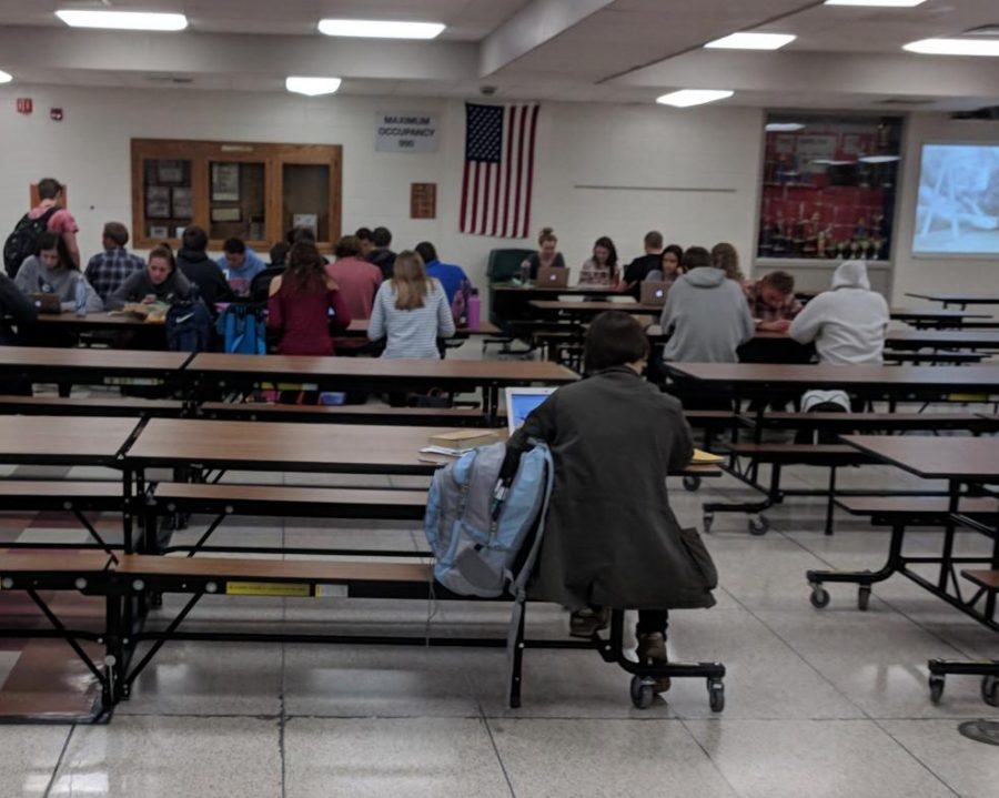 Kids in study hall working individually.