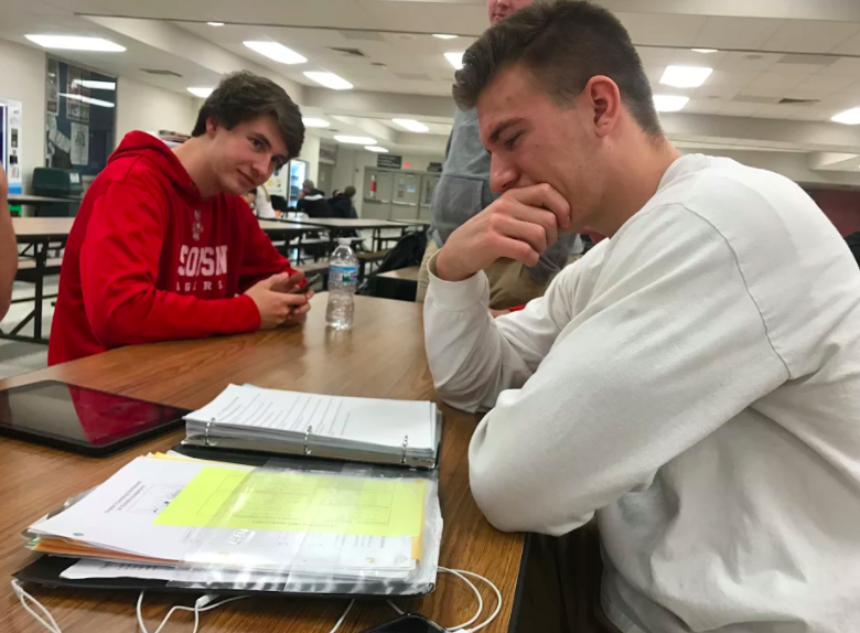 John Doleschy trying to stick to his new year's resolution by studying in senior study hall