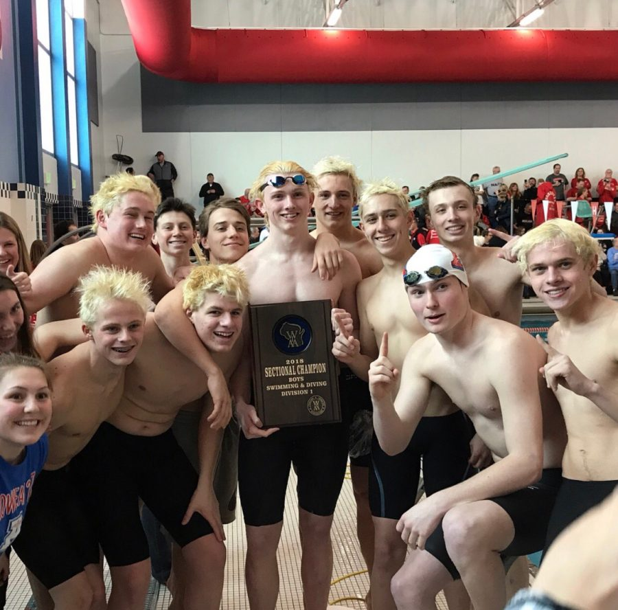 Swim Team members celebrate their victory at Sectionals.