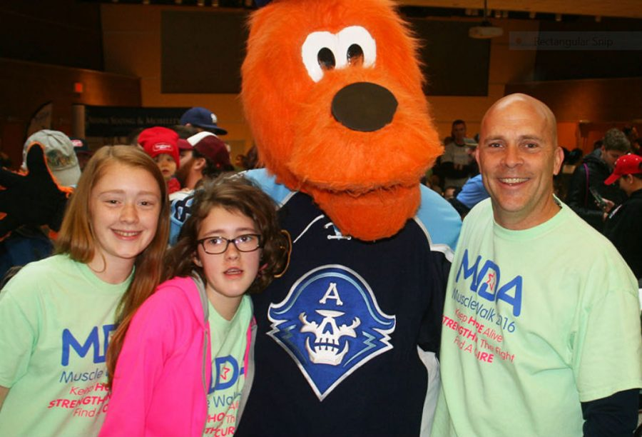 Erica Destache at the 2016 MDA Muscle Walk with her father and sister.