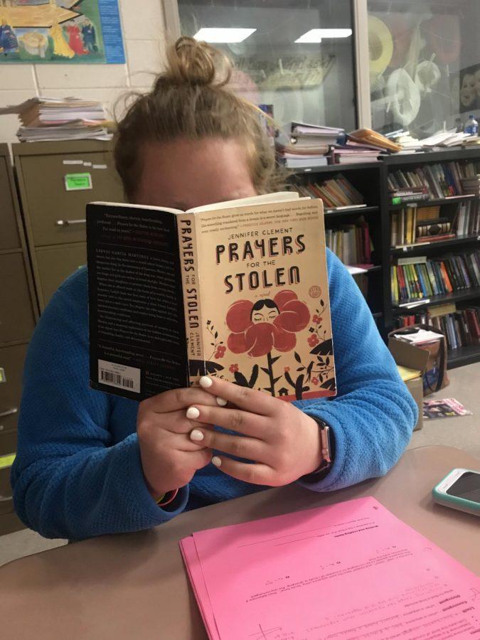 AHS senior Marleh Lehmann digging into a book about Mexico.