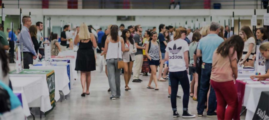 Students peruse colleges at the Milwaukee National College Fair.