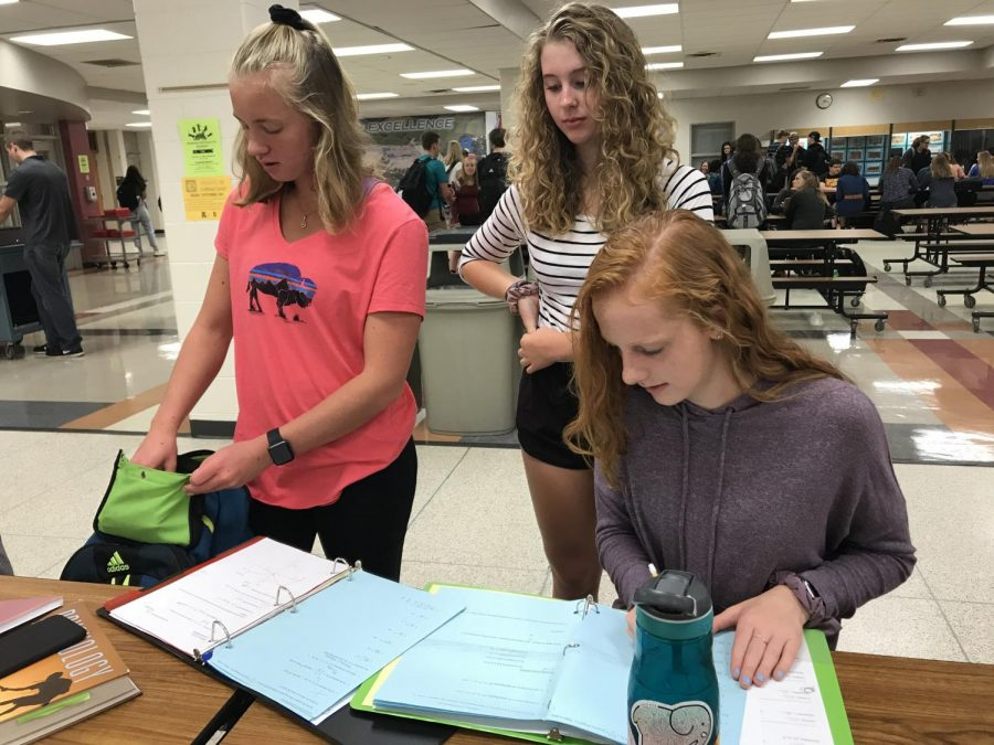 Arrowhead juniors, Lily Stemper, Alli Hofkamp, and Kendall Fullerton, work together to solve a math problem.