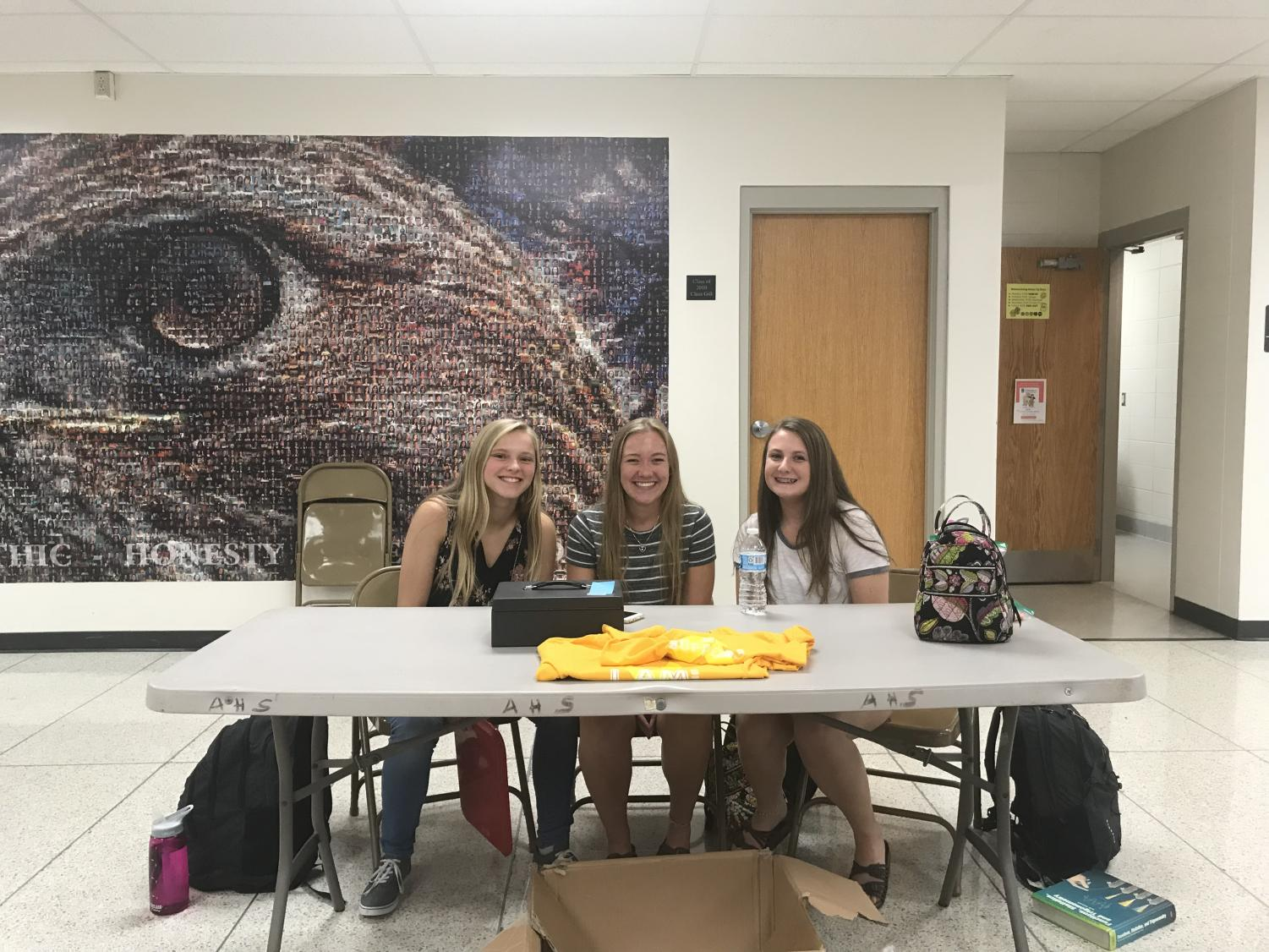 Megan Keenan, Katie Lynch, and Ashley Miller sell Gold in September t-shirts throughout the week.