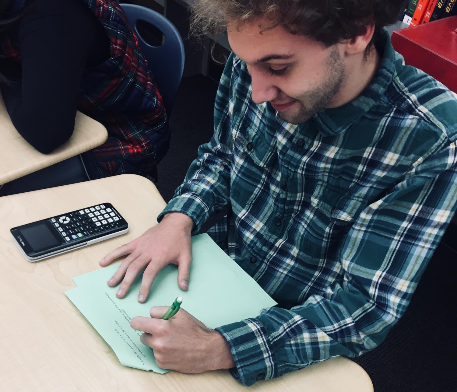 Arrowhead senior Benjamin Klein takes on his math homework with a smile.
