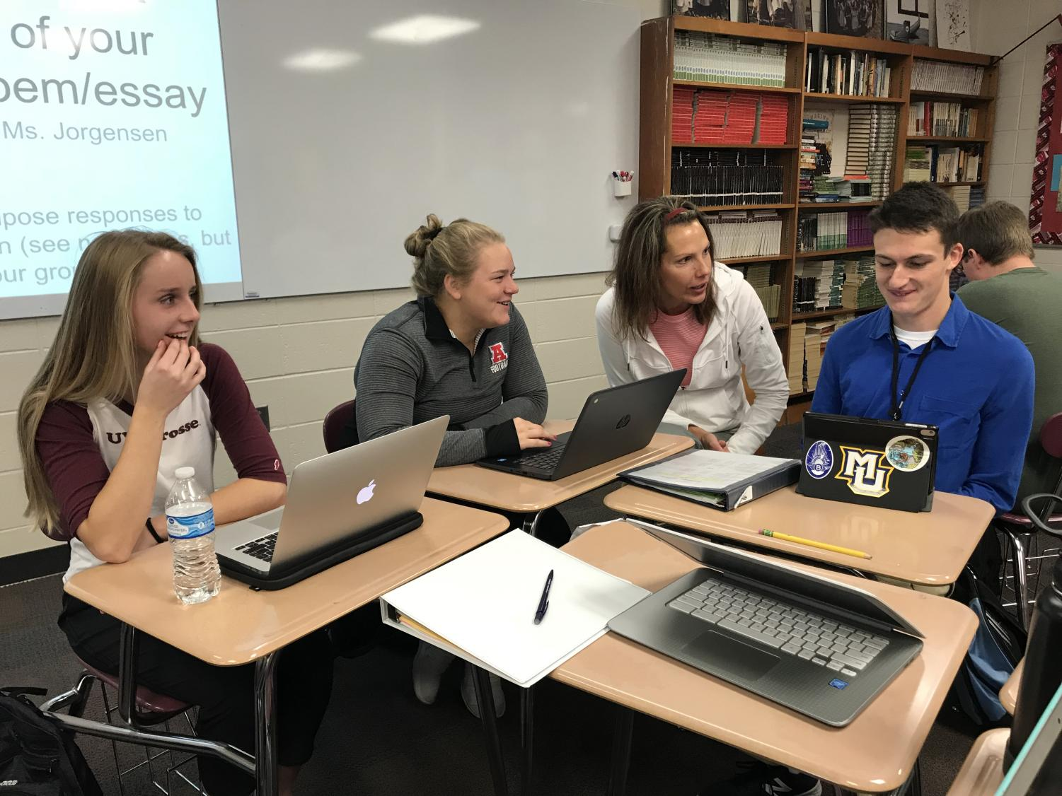 Heidi Hamilton works with a group of her students during class.
