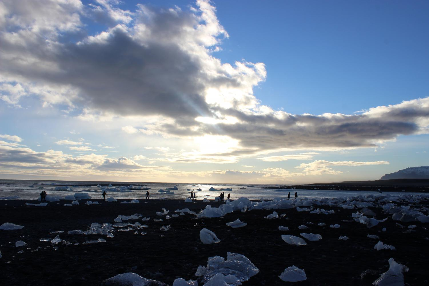 Far view of the sunlight reflecting off the ice at Crystal Beach in Southeast Iceland; on October 27