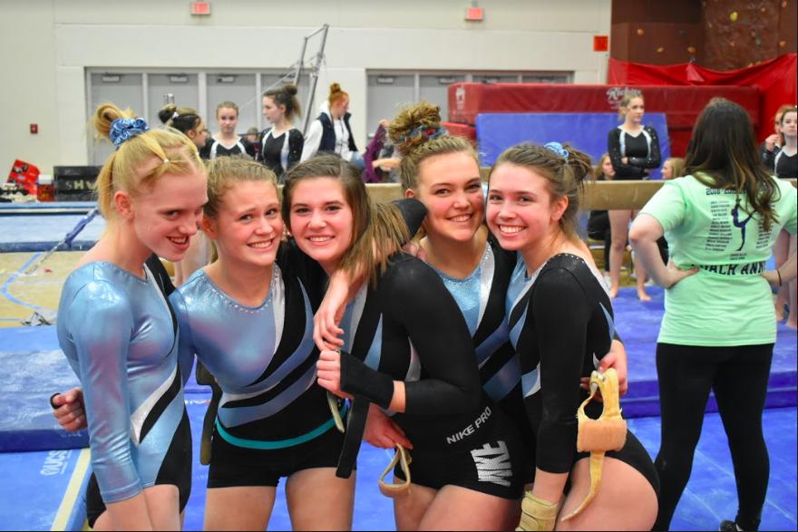 Gymnasts+Nina+Morrison%2C+Rachel+Diel%2C+Mackenzie+Rudy%2C+Alexis+Wioda%2C+and+Rachel+Brockish+at+their+home+meet+on+December+6th.+
