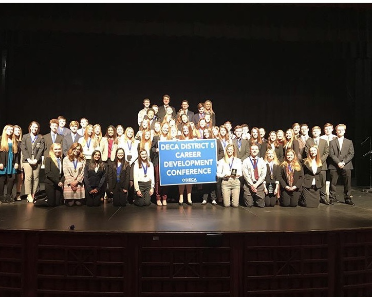 Arrowhead DECA students holding their medals and trophies after DECA districts competition